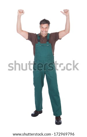 Portrait Of Excited Mature Male Gardener With Hand Raised - stock photo