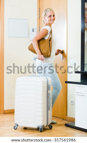 Portrait of excited russian female traveller going at holiday trip - stock photo