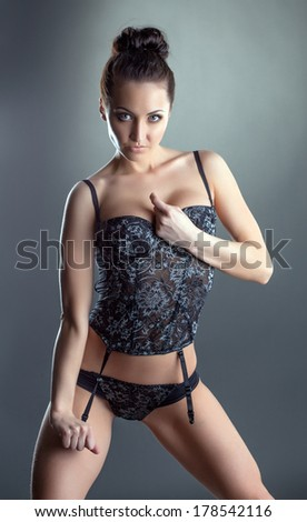 Portrait of excited young girl advertises lingerie