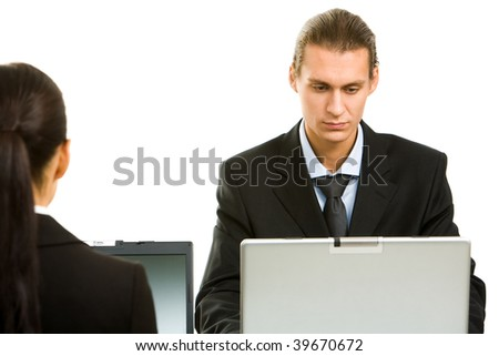 Portrait of executive employees working with laptop