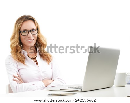 Portrait of executive financial advisor sitting in front of laptop. Isolated on white background. - stock photo