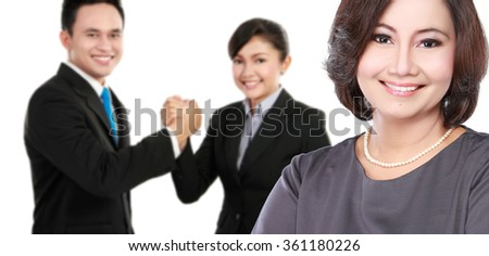 portrait of executive woman with team at the background - stock photo