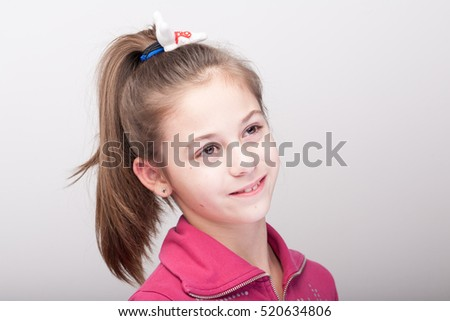 Portrait of expressive beautiful girl  looking at the camera