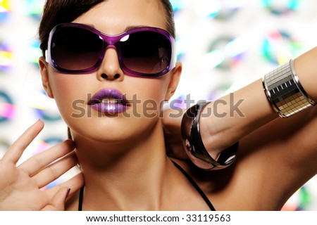 portrait of expressive beautiful young woman with stylish sunglasses - stock photo
