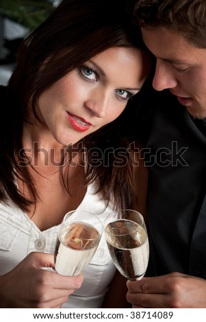 Portrait of extravagant man and woman with glass of champagne - stock photo