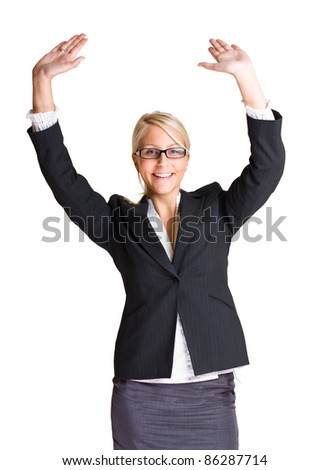 Portrait of exuberant gesturing young business woman with hands raised, isolated on white background.