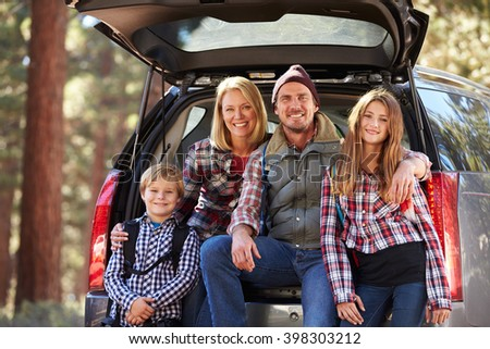 Portrait of family by their car before hiking, California
