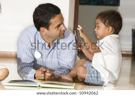 Portrait of family, father and son enjoying at home