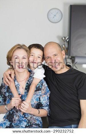 Portrait of family, Happy Family enjoying at home in the kitchen - stock photo