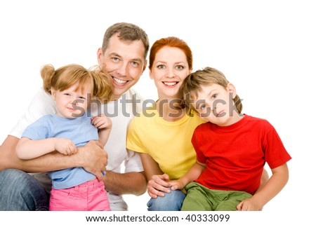 Portrait of family looking at camera on a white background - stock photo