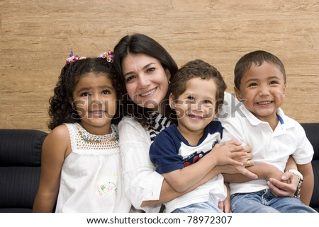 Portrait of Family, Mother Playing With His Children At Home - stock photo