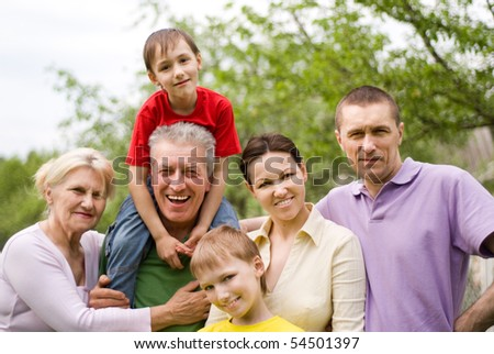 portrait of family of six on the nature