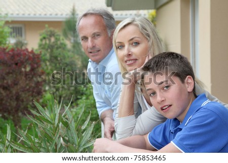 Portrait of family of three people - stock photo