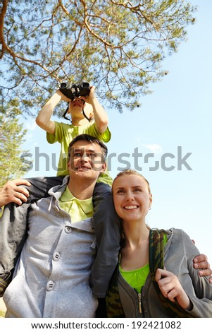 Portrait of family of travelers on summer vacation - stock photo