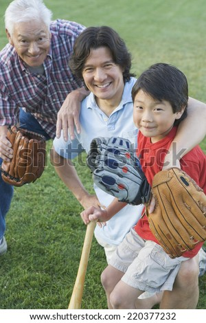 Portrait of family playing baseball
