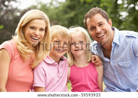 Portrait Of Family Relaxing In Countryside - stock photo