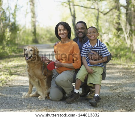 Portrait of family with dog on path