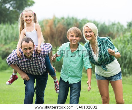 Portrait of family with kids enjoying vacation in village