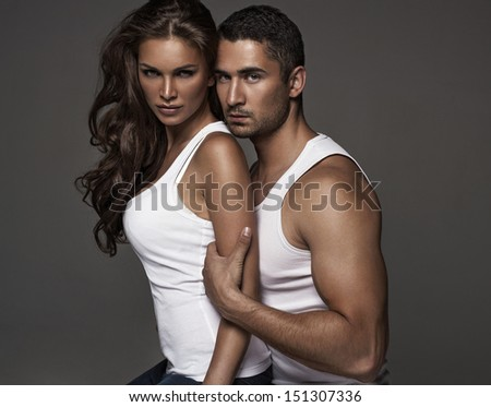 Portrait of fashion couple - stock photo