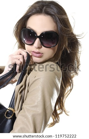 Portrait of fashion girl in sunglasses with bag - stock photo