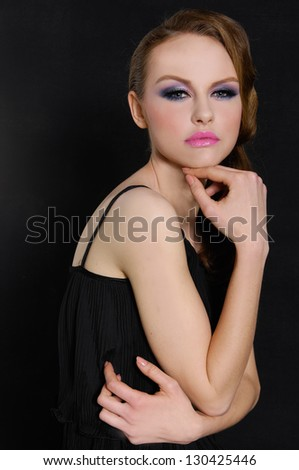portrait of fashion girl with bright make-up-black background