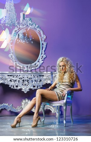 Portrait of fashion model posing in glamorous interior
