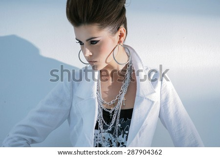 Portrait of fashion shot of girl s posing in light background  - stock photo