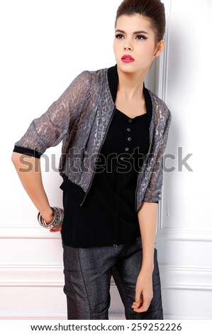 portrait of fashion shot of girl standing posing in studio  - stock photo