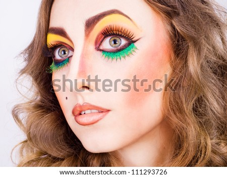 portrait of fashion woman model with beauty bright make-up. Beautiful famale face with clean skin.