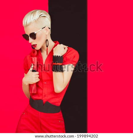 Portrait of fashionable girl in black red style - stock photo