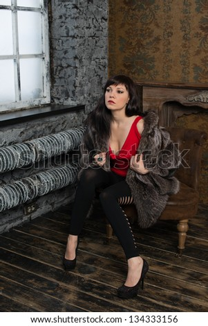 Portrait of fashionable gorgeous woman posing in a vintage interior, vertical shot - stock photo