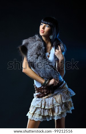 Portrait of fashionable woman fur covering the neck - stock photo