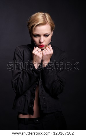 Portrait of fashionable woman that's feeling cold - stock photo