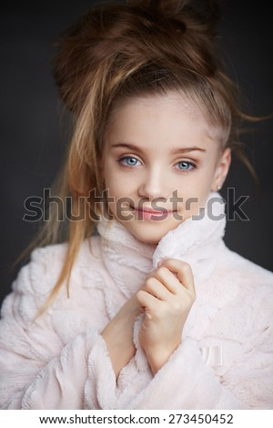 Portrait of fashionable young girl in white coat with long hair - stock photo
