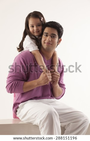 Portrait of father and daughter over white background - stock photo