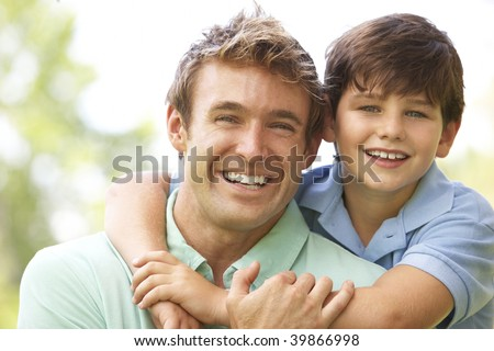 Portrait Of Father And Son In Park - stock photo