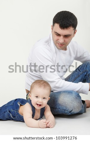 Portrait of father and son smiling on white background - stock photo
