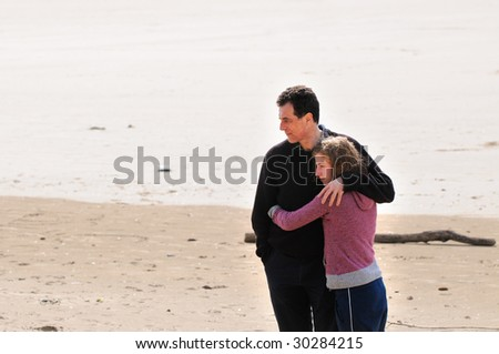 portrait of father and teenage daughter - stock photo