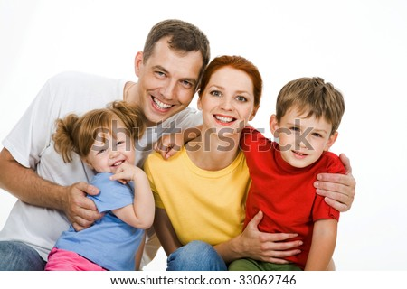 Portrait of father embracing her wife and children - stock photo