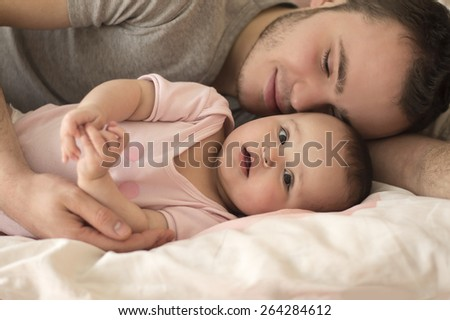 portrait of father  with baby daughter - stock photo