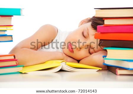 portrait of fatigued schoolgirl sleeping on book - stock photo