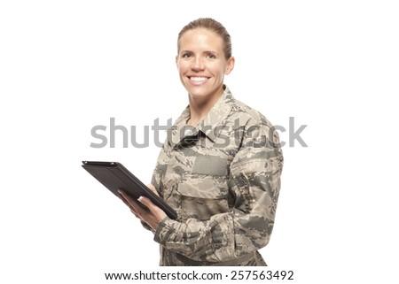 Portrait of female airman using digital tablet against white background - stock photo