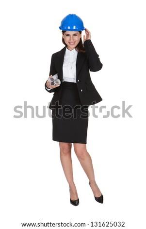 Portrait Of Female Architect Holding Blueprints One White Background - stock photo