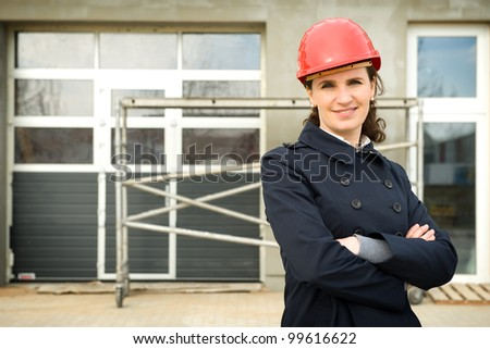 Portrait of female construction engineer in front of new industry building