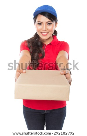 Portrait of Female delivery service happily delivering package to costumer - stock photo