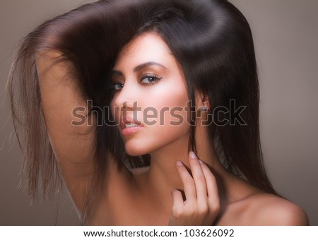portrait of female face with long beauty glossy hair - stock photo