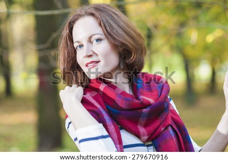 Portrait of Female Fashion Model Posing in Autumn Forest Outdoors.Horizontal Image Orientation - stock photo