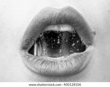 Portrait of female open mouth with film of saliva with beautiful lips and teeth, black and white - stock photo