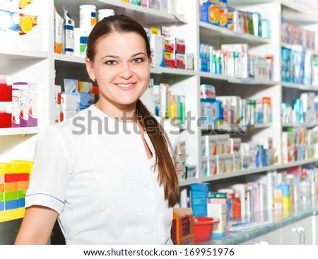 Portrait of female pharmacist at the drugstore - stock photo