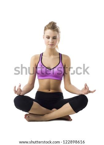 Portrait of female practicing yoga against white background - stock photo